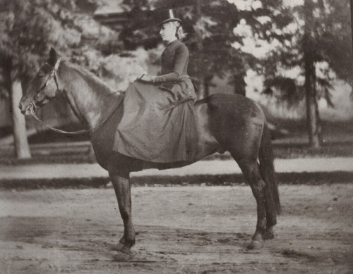 Black and white portrait of Mary on her horse Anticellere at Smith College in 1883