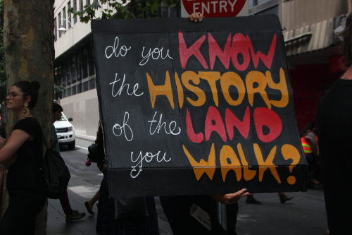 'Do you know the history of the land you walk?' placard at Australia Day protests in Melbourne, 2018.