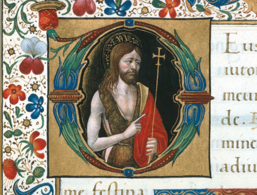 An initial in an illuminated manuscript, showing John the Baptist wearing animal skins