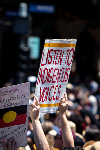'Listen to Indigenous Voices' placard at Australia Day protests on Melbourne, 2019