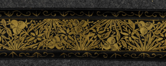 Detail from the black lacquered back cover with gilt floral decoration of a Thai royal manuscript containing Paññāsa Jātaka