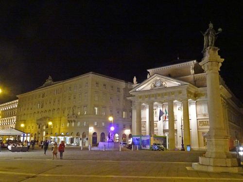 View of the Piazza della Borsa and the Borsa Vecchia, now the Chamber of Commerce of Trieste, at night.