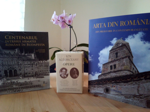 Photograph of three books from the Opere fundamentale collection and an orchid