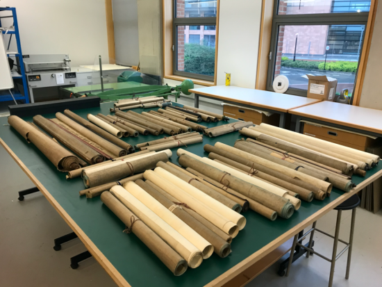 A large bench in the conservation centre with all the rolls when they arrived at the BLCC