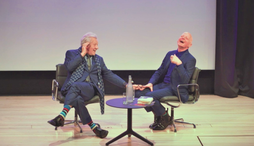 Michael Cashman on stage with Ian McKellen