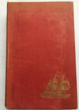 The picture of the front cover after conservation showing a red cover with a gold leaf ship in the lower right hand corner. Loss is no longer evident on the cover..