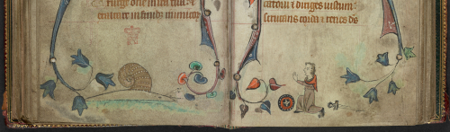 An opening from a Book of Hours, featuring a marginal illustration of an armed man surrendering to a snail.