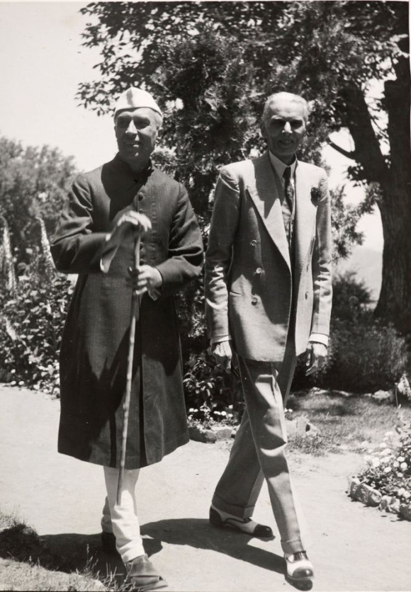 Pandit Jawaharlal Nehru & Mr M.A. Jinnah walking together in the grounds of Viceregal Lodge, Simla