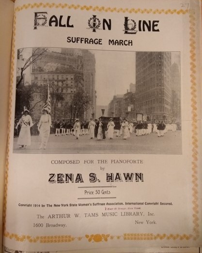 The cover photograph of this sheet music shows women in long white dresses and sashes marching in New York City for women's suffrage.