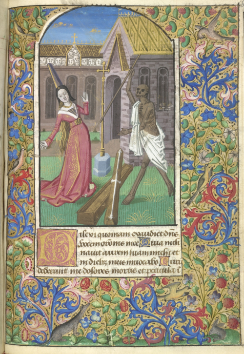 A medieval miniature of a lady encountering the figure of death in a graveyard