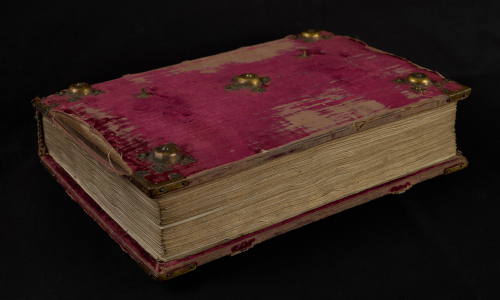 The Lucas Psalter binding of red velvet with metal bosses at the corners
