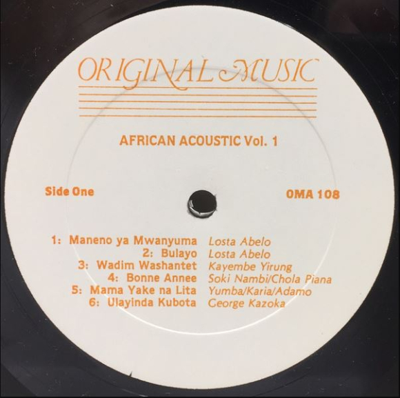 Centre label of African Acoustic Vol.1 - Guitar Songs From Tanzania  Zambia & Zaire