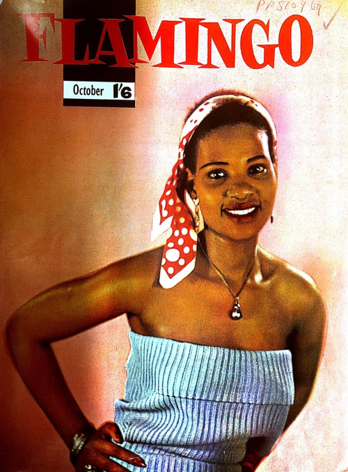 Front cover of the magazine with a woman posing in blue summer dress, a red and white head scarf and jewellery.