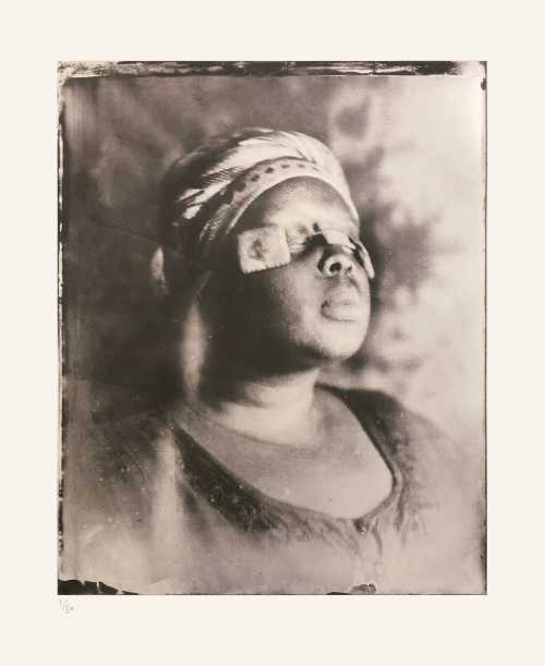 Khadija Saye with three small light-coloured squares, strung together, across her closed eyes