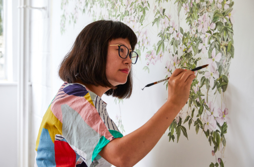 Sian Zeng painting one of her bespoke wallpapers