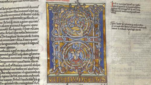 An illuminated 'Channel-style' initial 'H' with naked men and lions or dogs, in a copy of Gratian's Decretum