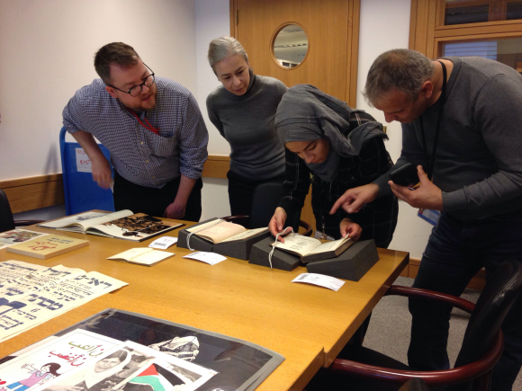 Picture 3: Bara and Baha being introduced to a selection of Arabic collection items by curator Daniel Lowe and head of Asian and African Collections Luisa Mengoni