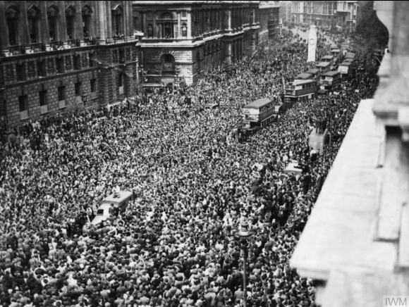 A line of London buses enmeshed in the vast crowd, occupying Whitehall on VE Day