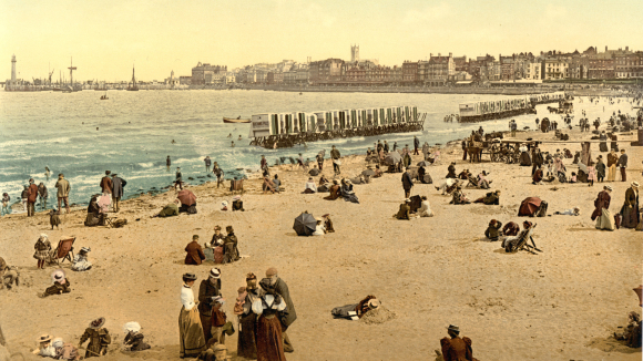 Colour photograph of holidaymakers at the seaside