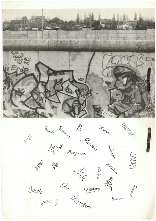 Back cover of the booklet, Mauer 89, with a photograph of the Berlin Wall and children's signature