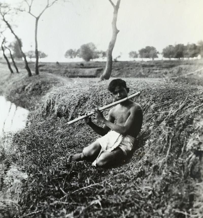 3. Santali flute player by pond