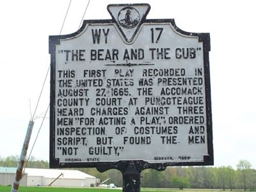 A contemporary heritage plaque indicating where 'The Bear and the Cub' was performed.