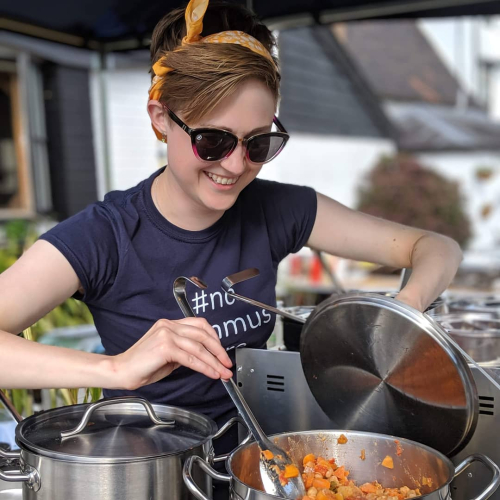 Evie-May founder of Heart Street stirring a pot at her stall