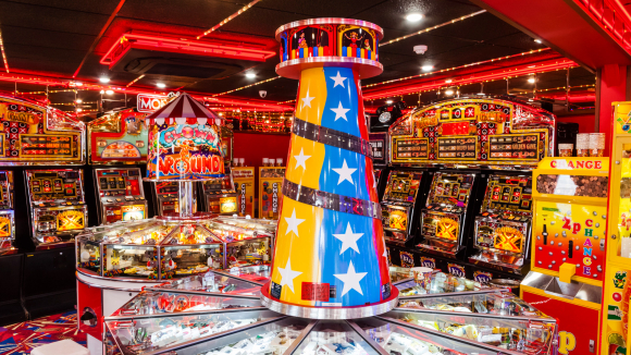 Colour photograph of the inside of a seaside amusement arcade