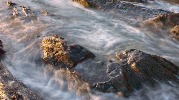 Colour photograph of a rock pool