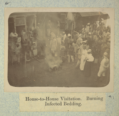 'House to House Visitation. Burning Infected Bedding'. Photograph by Captain C. Moss. 1896-97. British Library, Photo 311/1(91)