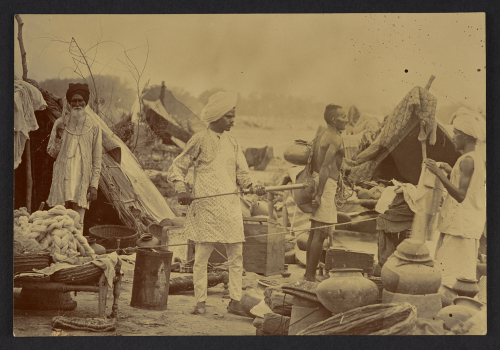 Bombay plague observation camp: spraying detainee with disinfectant'. Photographed by Captain C. Moss, 1896-97. British Library, Photo 311/1(139)