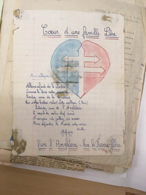 A handwritten poem entitled 'Coeur d'une famile libre', illustrated with a heart enclosing the Cross of Lorraine