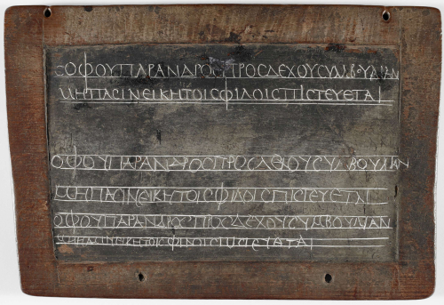An ancient wax tablet showing the handwriting of a teacher and pupil