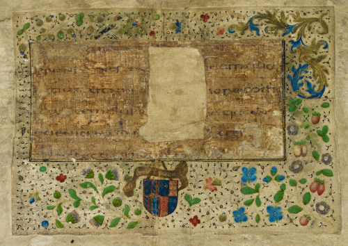 A detail of a mounted papyrus fragment added to a leaf from the Breviary of Margaret of York.