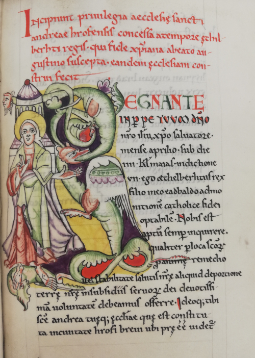A page with a medieval script copied by Elizabeth Elstob, featuring an introduction in red, initials in green and red, and a decorated initial featuring Christ and a dragon in green, purple, and red against a yellow background.