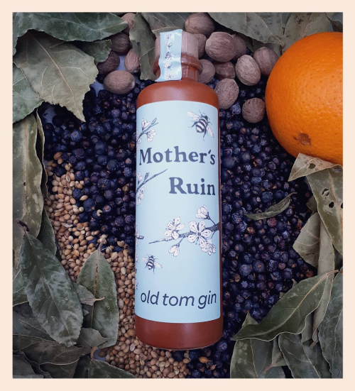 Mother's Ruin gin bottle on bed of botanicals