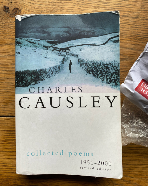Photograph of front jacket for Collected Poems by Charles Causley next to a British Library envelope