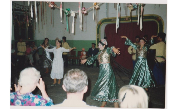 Uyghur dancers performing to an audience of tourists