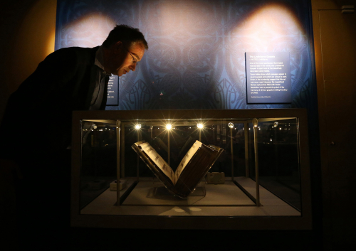 A photograph of the Lindisfarne Gospels in a glass display case at Durham in 2013