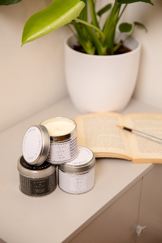 Tin candles with book