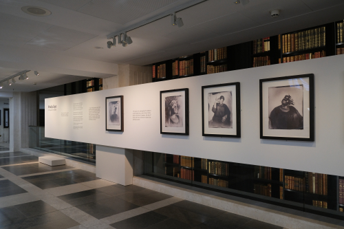 Photo of display of four works by Khadija Saye with accompanying text