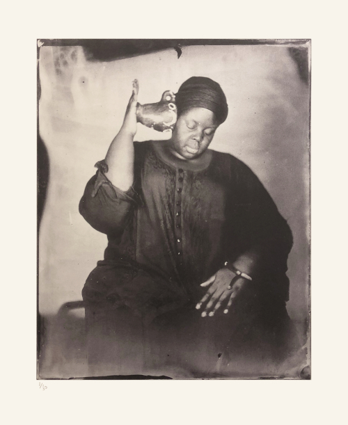Khadija Saye holds a pot to her ear