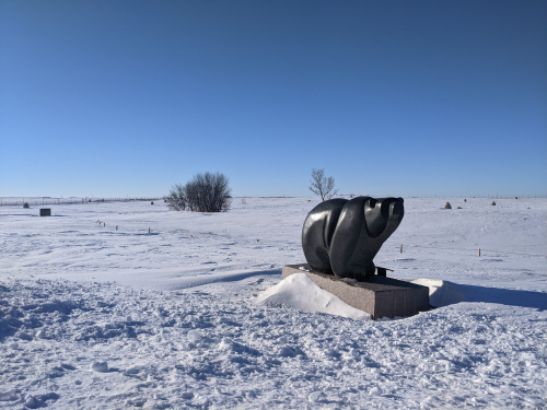Picture of two black bear sculptures in the snow at Wanuskewin Heritage Park