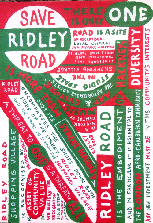 Red, white and green painted flyer with text