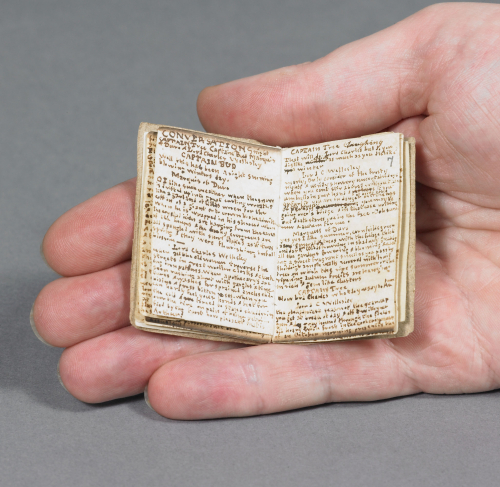 Photograph of hand holding miniature book, Blackwood's Young Mens' Magazine