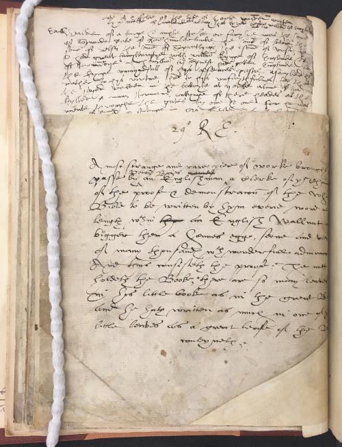 A note in a manuscript describing a miniature manuscript written by Peter Bales