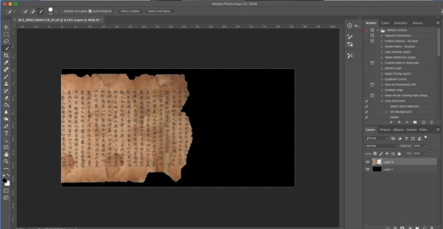 Gray frame of a computer application with coloured icons around an image of the end of a yellowed scroll with Chinese characters on it with a black background