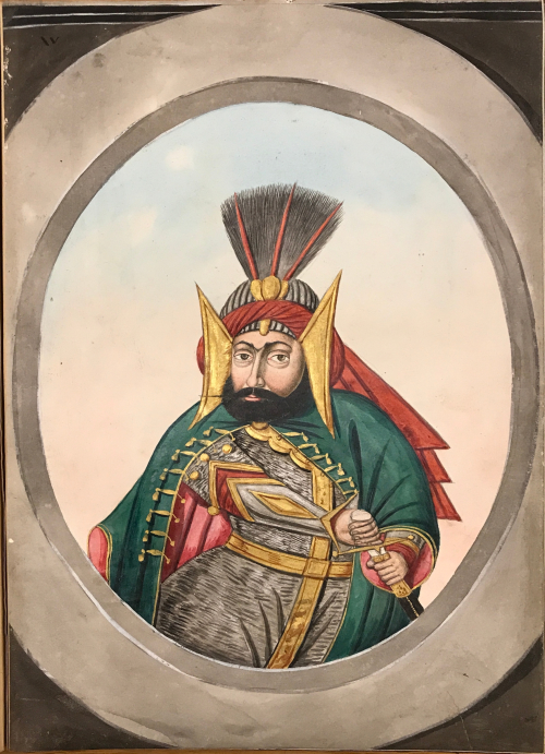A middle-aged man in a blue robe under a green cape with his hand on the hilt of his sword. He is wearing a striped black and white turban with a red cloth tied around it, topped with a gold and feathered standard, and large gold triangles on either side of his head