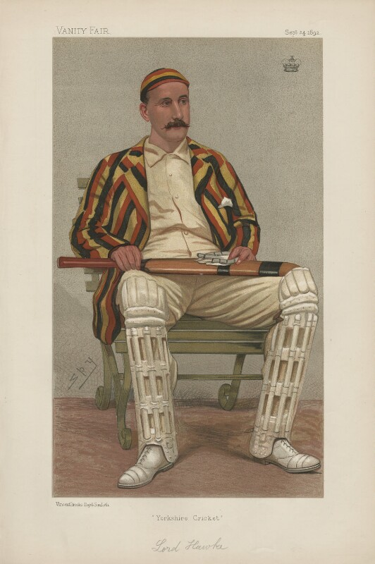 Portrait of Lord Hawke in his cricket whites and pads, with a striped blazer and cap