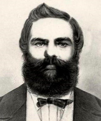 Head and shoulders portrait of Captain Stafford Bettesworth Haines with a full, dark beard and bow tie